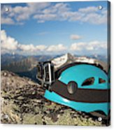 Climbing Helmet With Camera On Mountain Acrylic Print