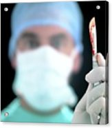 Close-up Of Blood-stained Scalpel Held By Surgeon Acrylic Print