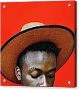 Close-up Of Man Wearing Hat Against Red Acrylic Print