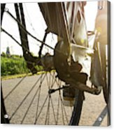 Close Up Of Wheel Of Bicycle On Road Acrylic Print
