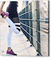 Close-up of woman stretching legs after running Acrylic Print