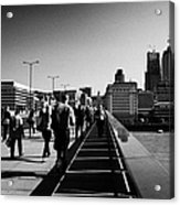 commuters and city workers cross london bridge over the river thames in the morning central London England UK Acrylic Print