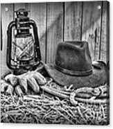 Cowboy Hat And Rodeo Lasso In A Black And White Acrylic Print by Paul Ward