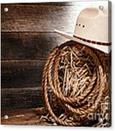 Cowboy Hat On Hay Bale Acrylic Print by Olivier Le Queinec