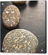 Curving Line Of Speckled Grey Pebbles On Dark Background Acrylic Print