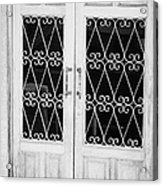 double wooden doors with wrought iron decorative window guards Tenerife Canary Islands Spain Acrylic Print