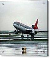 Douglas Dc-10-40 Taking Off In The Rain Acrylic Print by Wernher Krutein