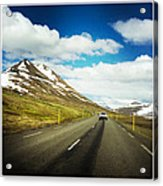 Driving in Iceland - road and mountain landscape Acrylic Print