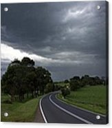 Driving Into A Storm Acrylic Print by Lee Stickels