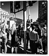 early morning commuters waiting to cross the road pedestrian crossing London England UK Acrylic Print