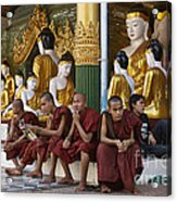 faithful Buddhist monks siiting around Buddha Statues in SHWEDAGON PAGODA Acrylic Print