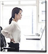 Female employees are suffering from low back pain Acrylic Print