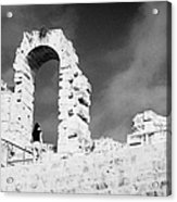 Female Tourist Walks Up The Stepped Seating Area Towards Ruined Archways Of The Old Roman Colloseum At El Jem Tunisia Acrylic Print