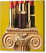 Five Red Lipstick Tubes On Pedestal Acrylic Print