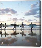 Five Surfers Walk Along Beach With Surf Acrylic Print