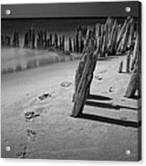 Footprints In The Sand Among The Pilings Acrylic Print