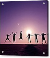 Friends Jumping Against Sunset Acrylic Print
