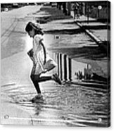 Girl Playing In A Puddle Acrylic Print by Retro Images Archive