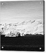 glacial shoreline with snow cap on anvers island and neumayer channel Antarctica Acrylic Print