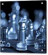 Glass Chessmen Arranged On Black Background Acrylic Print