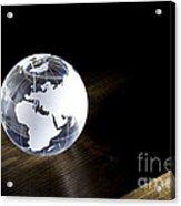 Glass Globe On Wooden Floor Acrylic Print
