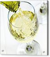 Glass Of White Wine Being Poured Acrylic Print