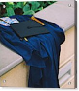 Graduation Gown With Mortarboard On Retaining Wall Acrylic Print