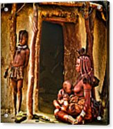 Himba Family By The Door Of Their Clay Hut Acrylic Print by Paul W Sharpe Aka Wizard of Wonders