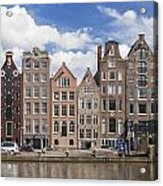Historic Buildings Along The Damrak Canal In Amsterdam Acrylic Print