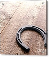 Horseshoe On Wood Floor Acrylic Print