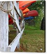 Kayaks On A Fence Acrylic Print