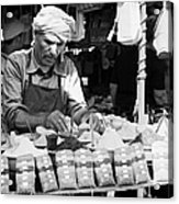 Local Arab Man Measuring Out A Quantity Of Spice For Sale On Stall Of Spices At The Market In Nabeul Tunisia Acrylic Print by Joe Fox