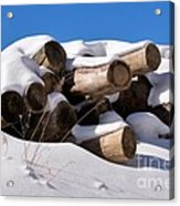 Log Pile In A Snow Drift In Winter Acrylic Print