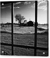 looking out through door window to snow covered scene in small rural village of Forget Saskatchewan  Acrylic Print