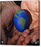 Man Holding Earth Egg Acrylic Print by Jim Corwin