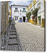 Medieval Cobblestone Street In The Fortified Walled European Village Of Obidos Acrylic Print