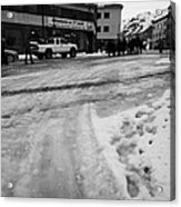 melting ice and snow on street surface holmen Honningsvag finnmark norway europe Acrylic Print