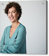 Mid adult businesswoman headshot on grey background. Acrylic Print