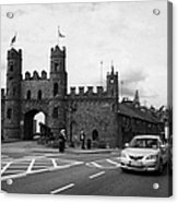 modern traffic driving past Entrance to Macroom Castle County Cork Ireland Acrylic Print