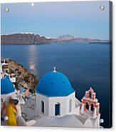 Moon Over Blue Domed Church In Oia Santorini Greece Acrylic Print by Matteo Colombo