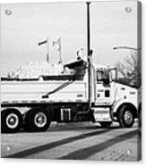 municipal city dump truck taking away snow cleared from parking lots and roads in Saskatoon Saskatch Acrylic Print