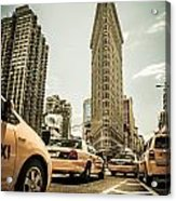 Nyc Yellow Cabs At The Flat Iron Building - V1 Acrylic Print by Hannes Cmarits