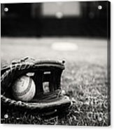 Old Baseball And Glove On Field Acrylic Print by Danny Hooks