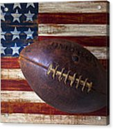 Old Football On American Flag Acrylic Print by Garry Gay