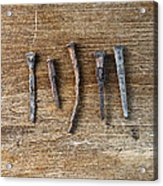 Old Nails On A Wooden Table Acrylic Print