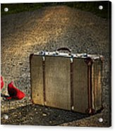 Old Suitcase With Red Shoes Left On Road Acrylic Print by Sandra Cunningham