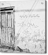 old weathered green painted wooden door entrance to abandoned house with cracked stucco walls and graffitti in Tacoronte Tenerife Canary Islands Spain Acrylic Print
