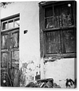 old weathered wooden door entrance to abandoned house 18 with window and cracked stucco walls in Los Banquitos Tenerife Canary Islands Spain Acrylic Print