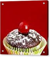 One Chocolate Cupcake With Cherry Over Red Acrylic Print