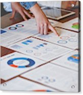 Paperwork and hands on a board room table at a business presentation or seminar. Acrylic Print